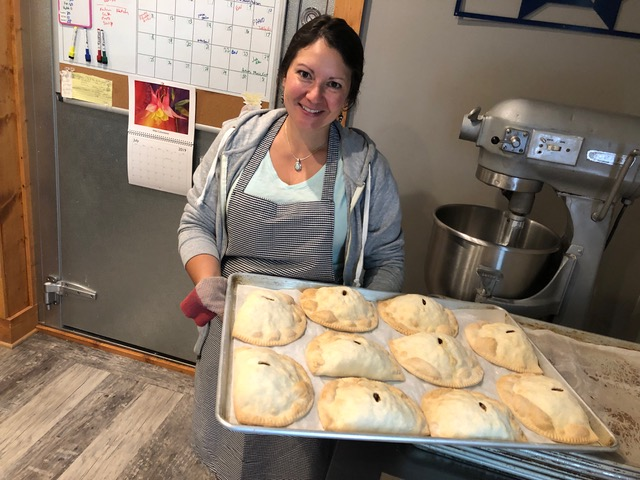 Joe's Pasty Shop owner Jessica Lapachin with a tray of pasties. (Jane Genske/WPR)