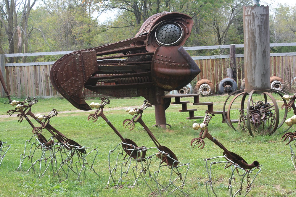 "Scrap metal sculptures of Dr. Evermor. (Photo by <a href=""https://www.flickr.com/photos/killkudzu/6919214631/"" target=""_blank"" rel=""noopener noreferrer"">Michael Lusk</a>)"