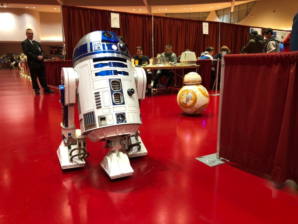 R2-D2 and BB-8 droids built in Wisconsin roll together at the Madison Mini Maker Faire in November 2019. (Maureen McCollum/WPR)