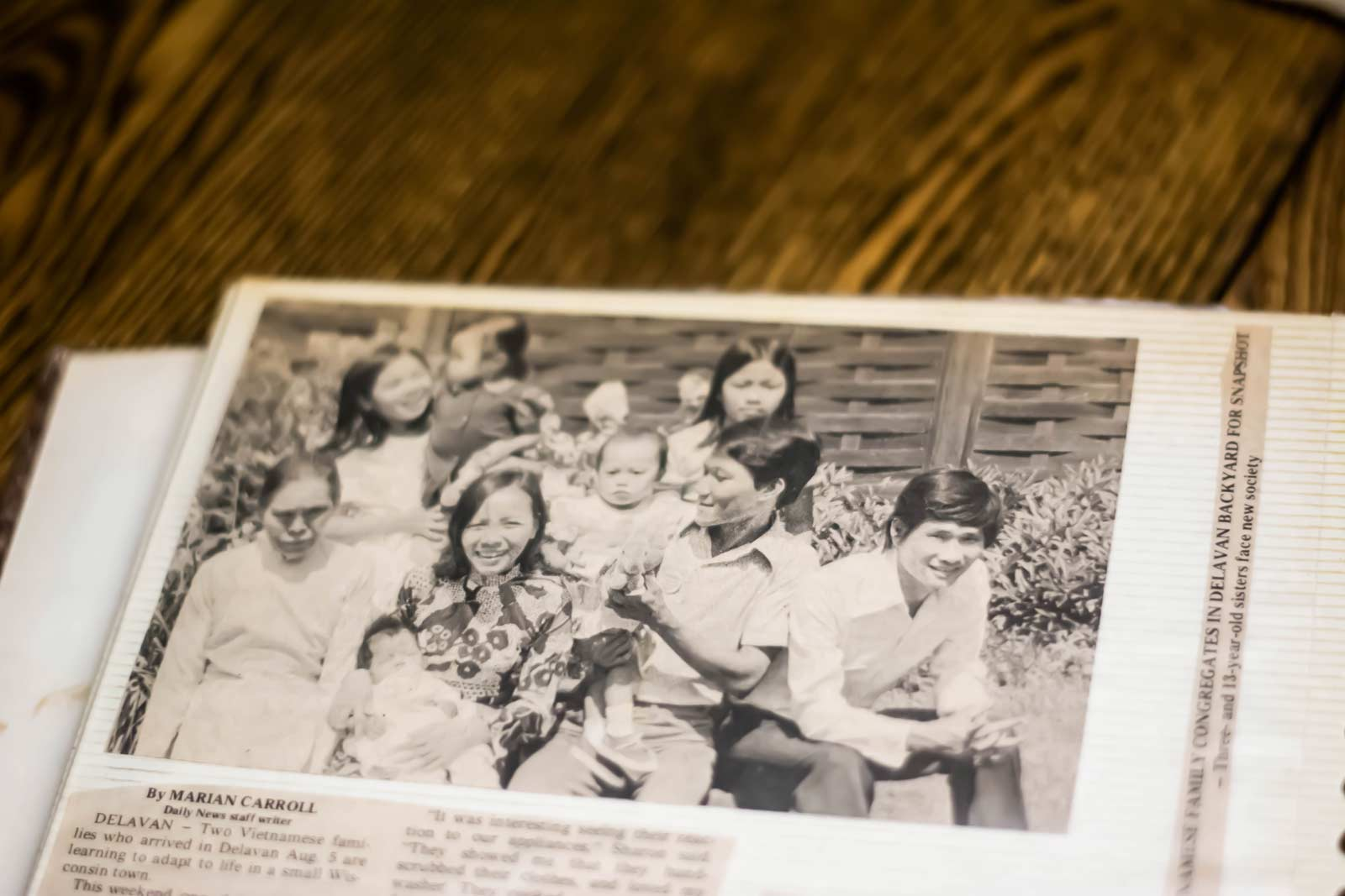 A newspaper photograph of Carina Tran's family.