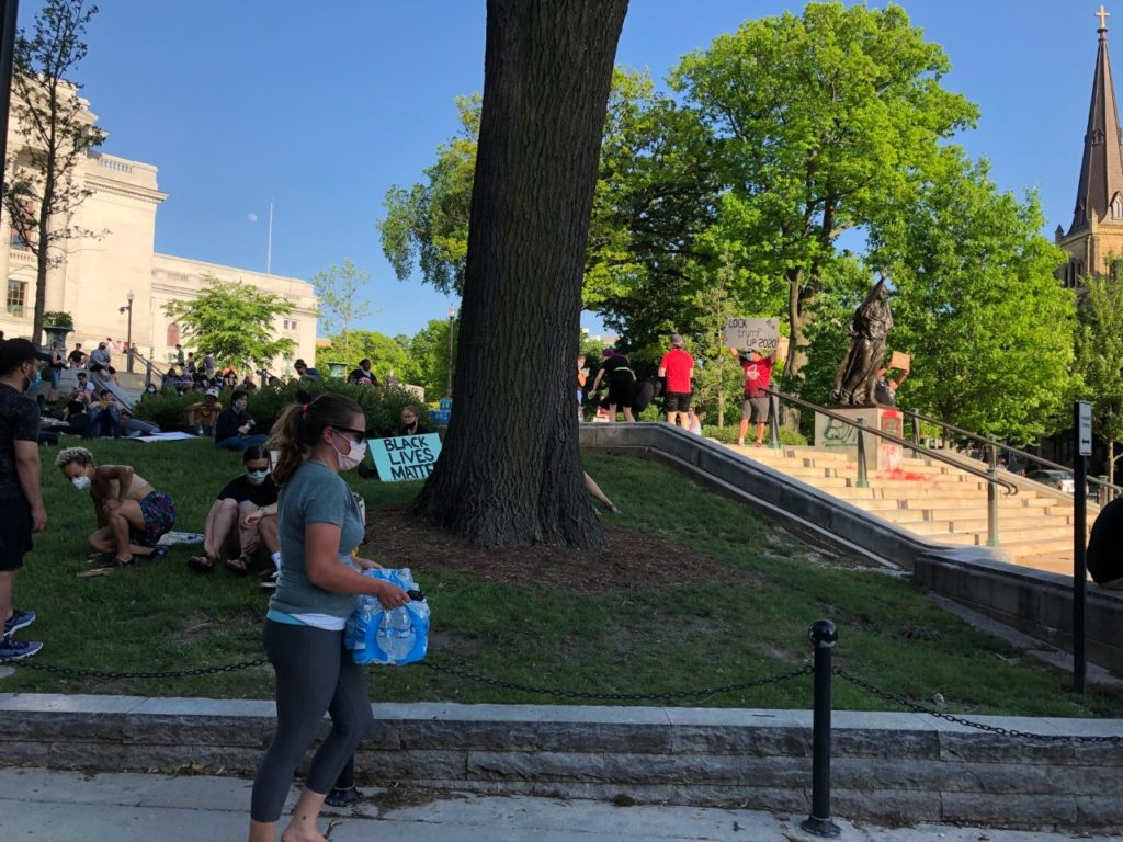 Demonstrators on the Capitol lawn in Madison, Wisconsin on June 2, 2020. Most people ate donated pizza while many wore 'Black Lives Matter' shirts. (Maureen McCollum/WPR)