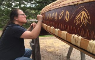 Wayne Valliere of the Lac du Flambeau Band of Lake Superior Chippewa etching a birchbark canoe in 2015. (Courtesy of Wayne Valliere/Native Arts & Cultures Foundation)