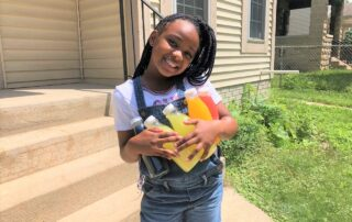 Kyric Burt, the nine-year-old owner of Kyric's Lemonade, holds her five flavors. (Maureen McCollum/WPR)