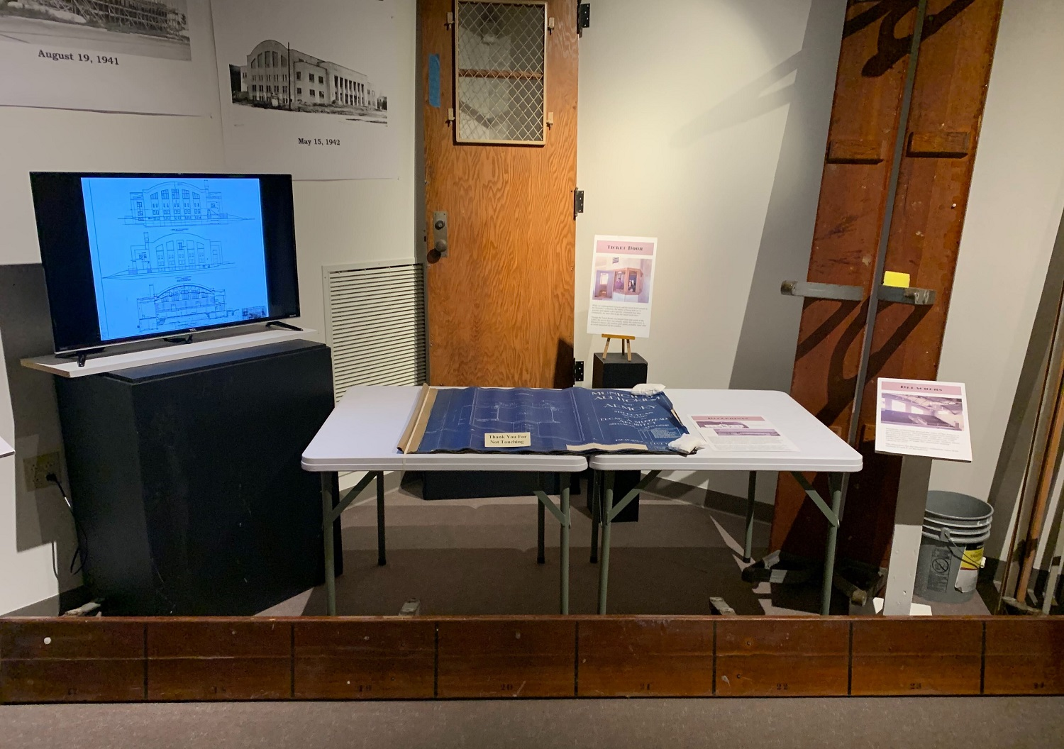 The Sheboygan County Historical Society and Museum preserved items from the Armory to keep its memory alive for future generations, said Executive Director Travis Gross. The building's original blueprint, bench seats and the door to the ticket booth are on display. (Megan Hart/WPR)