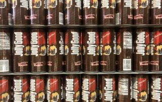 A stack of Jolly Good's root beer in the Krier Foods warehouse in Random Lake, Wis. (Rachael Vasquez/WPR)