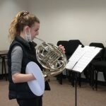 Anna Wisniewski leads a French horn sectional. (Photo by Jessica Gatzow)