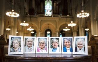 From left, photos of Sister Mary Francele Sherburne, Sister Josephine Seier, Sister Bernadette Kelter, Sister Mary Regine Collins, Sister Marie June Skender and Sister Annelda Holtkamp can be seen inside of a chapel in Milwaukee. The six died from complications of COVID-19. (Angela Major/WPR)